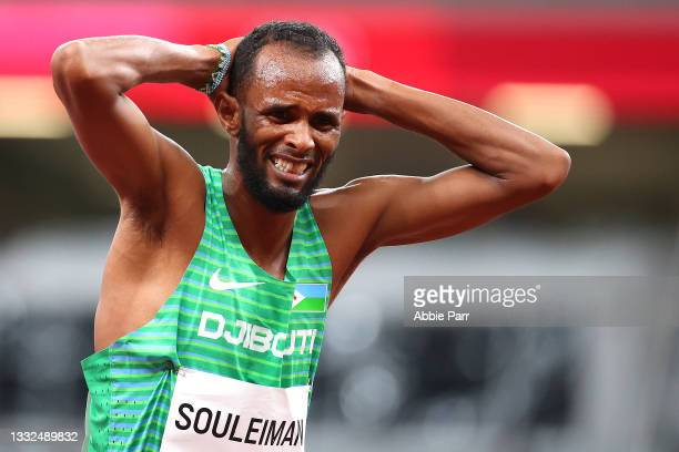 Ayanleh Souleiman of Team Djibouti reacts after being injured during the Men's 1500m Semifinal on day thirteen of the Tokyo 2020 Olympic Games at...