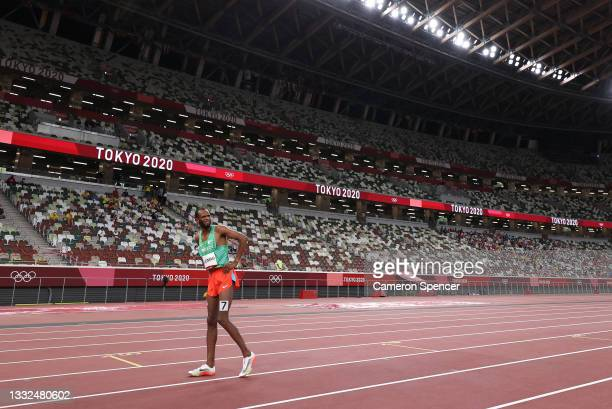 Ayanleh Souleiman of Team Djibouti reacts as he sustains an injury in the Men's 1500m Semi Final on day thirteen of the Tokyo 2020 Olympic Games at...