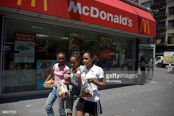 Ayanna Behagen right Alancia Eady center and a third unidentified friend leave a McDonald's restaurant in New York Thursday May 24 2007 McDonald's...