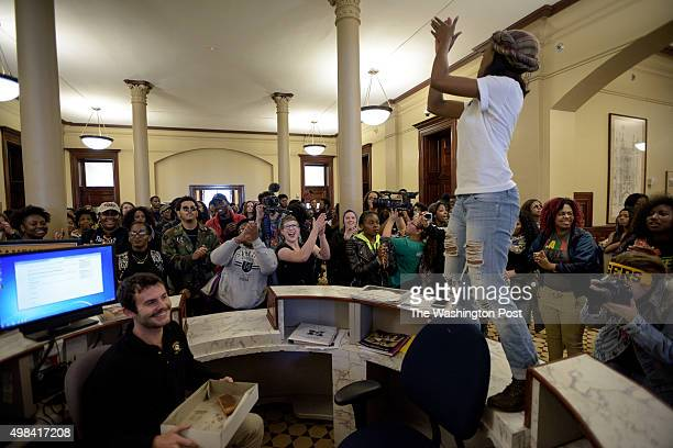 Ayanna Poole one of the Original 11 organizers of the protests stands on the reception in Jesse Hall central building during a march through...