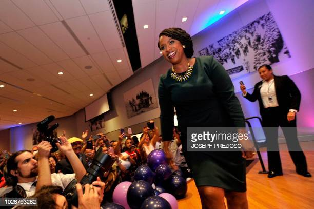 Ayanna Pressley Boston City Council member and Democratic candidate for congress greets supporters before giving her victory speech at the IBEW Local...