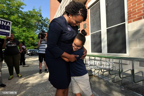 Ayanna Pressley Democratic candidate for Congress gets a hug from a girl who said she voted for the candidate at the Mildred Middle School and...