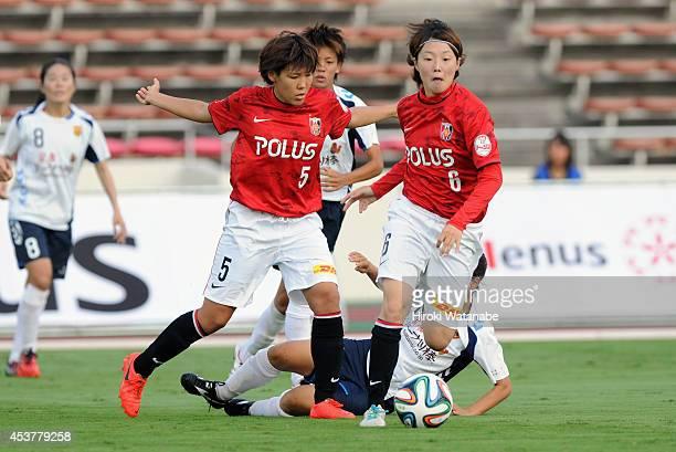 Ayano Dozono and Natsuki Kishikawa of Urawa Reds in action during the Nadeshiko League match between Urawa Red Diamonds Ladies and INAC Kobe Leonessa...
