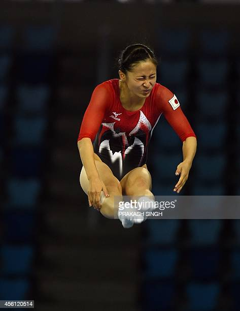 Ayano Kishi of Japan competes in the women's final for the gymnastics trampoline event at the Namdong Gymnasium during the 17th Asian Games in...
