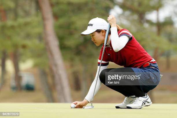Ayano Nitta of Japan lines up for her putt on the 18th green during the final round of the Hanasaka Ladies Yanmar Golf Tournament at Biwako Country...