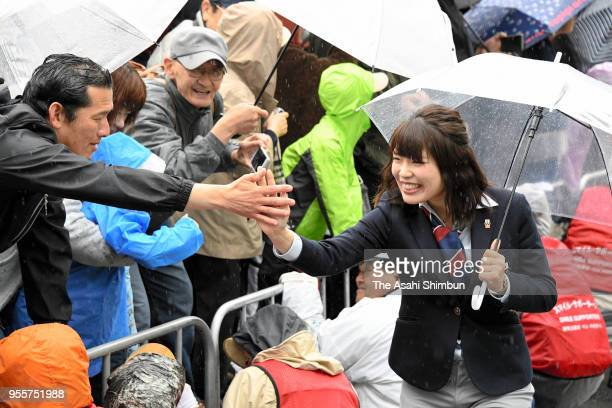 Ayano Sato high fives with fans during the homecoming ceremony on May 6 2018 in Sapporo Hokkaido Japan