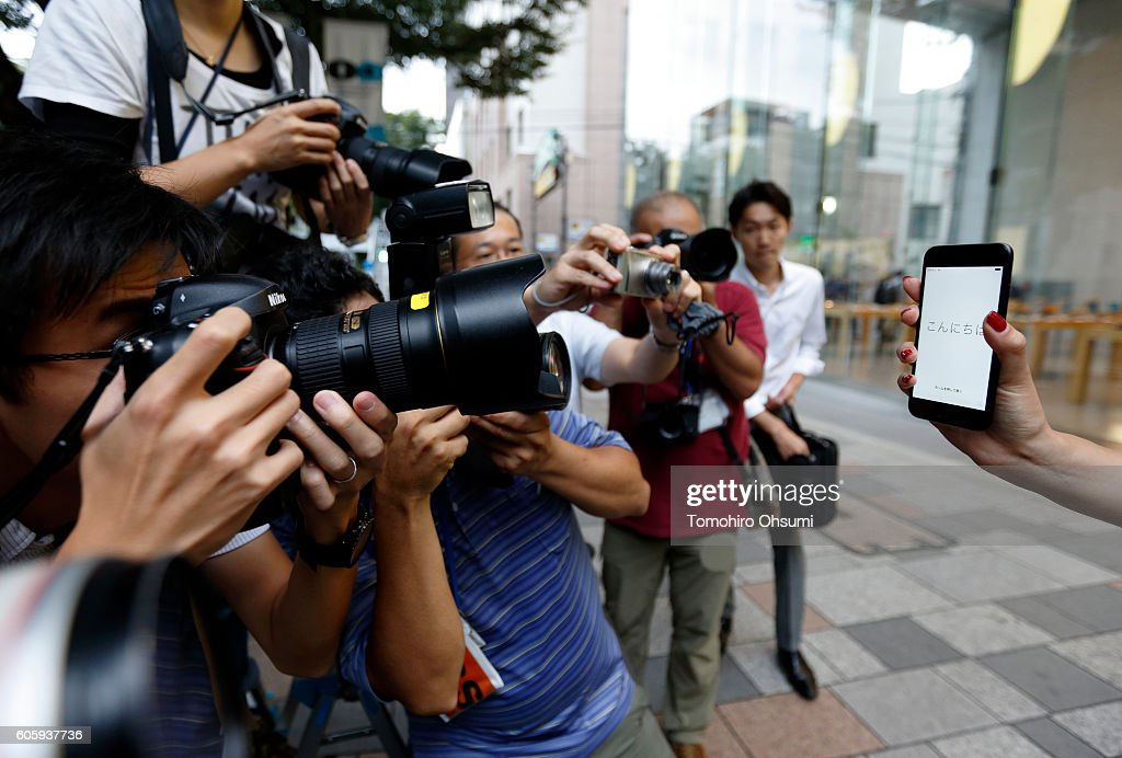 Ayano Tominaga holds her Apple Inc. iPhone 7 after purchasing it at the company's Omotesando store on September 16, 2016 in Tokyo, Japan. Apple's iPhone 7 and Apple Watch Series 2 go on sale in Japan today.