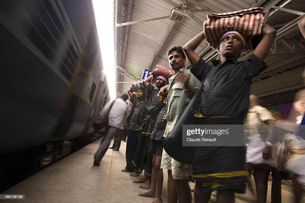 CONTENT] Ayappa pilgrims waiting for their train in Tirupati train station. You can come across those pilgrims in Southern India from November to february. The pilgrimage takes place in Sabarimala, Kerala. What they have on their head is called Irumudi, a holy bundle.