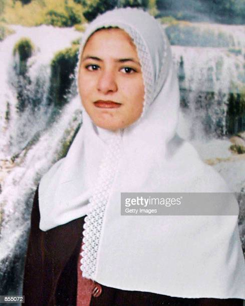 Ayat Al-Akhrass poses in front of a poster of waterfalls in a photograph made available by her family March 29, 2002 in the Daheisheh refugee camp...