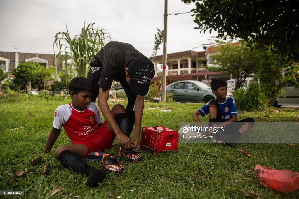 Ayat Ullah Bin Jafar, 17, the youngest member of the Rohingya Football Club, coaches local Rohingya children in his neighborhood in the evening on April 10, 2018 in KUALA LUMPUR, Malaysia. Ayat left his home in Maungdaw, Myanmar by boat with his mother and two brother when violence errupted in 2012. Now he attends high school at the Ideas Acadamy, a refugee school, which will allow him to further his education. Ayat says he likes coaching the children in his neighborhood, bring the the community together and teaching the kids a skill. A group of Rohingya refugees from Myanmar's Rakhine State formed the Rohingya Football Club in Malaysia back in 2015, hoping to give the Rohingya people a voice through sports and raise their international profile amidst the crisis in the region. Rohingya Muslims are reportedly playing in Football Clubs around the world, including Canada, Australia, and Ireland, while the Rohingya F.C. aims to set up a national team which comprises of these players and show that Rakhine Muslims can succeed in the sport. The United Nations estimate that over 62 thousand Rohingya are currently living in Malaysia and most of them are only able to find jobs as a construction worker or laborer with many staying in makeshift homes near construction sites. Malaysia launched its first Rohingya tournament this year with 24 independent football clubs competing across the Muslim country, hoping to gather support from the Malaysian and Turkish governments to help them succeed at an international level. Over 700,000 Muslim Rohingya have crossed the border into Bangladesh since August last year after the Myanmar military launched a brutal crackdown which was described by the United Nations as 'ethnic cleansing' while the two countries continue to negotiate the repatriation of the Rohingya refugees.