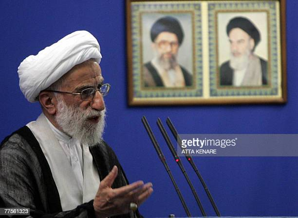Ayatollah Ahmad Jannati attends Friday prayer in Tehran 07 July 2006 in front of portraits of late Ayatollah Ruhollah Khomeni and his successor...