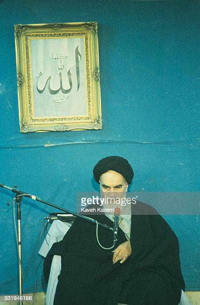 Ayatollah Khomeini sits on the balcony behind the microphone in Jamaran mosque on 1st March 1982