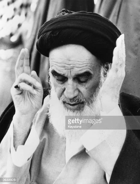 Ayatollah Khomeini the Iranian religious and political leader praying