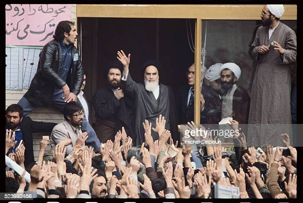 Ayatollah Khomeini waves to a crowd of enthusiastic supporters on his return to Tehran