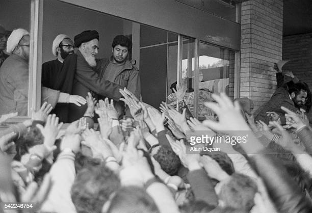 Ayatollah Ruhollah Khomeini greets the crowd at Tehran University after his return to Iran from exile in France during the Iranian Revolution.