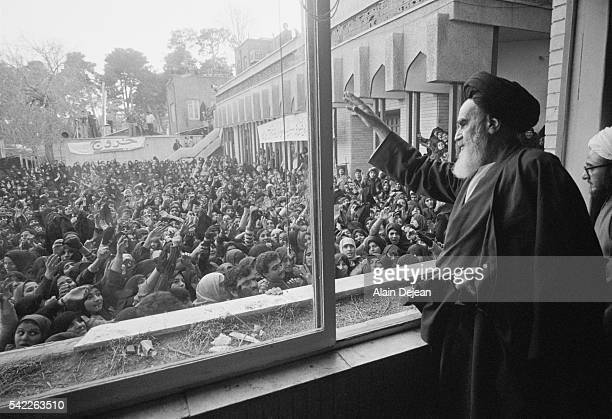 Ayatollah Ruhollah Khomeini greets the crowd at Tehran University after his return to Iran from exile in France during the Iranian Revolution