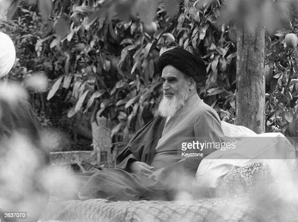Ayatollah Ruhollah Khomeini Iranian Shiite religious and political revolutionary leader sits in a garden in Pontchartrais on the outskirts of Paris...