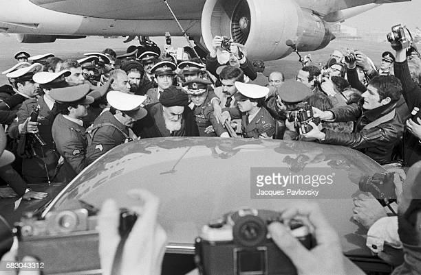 Ayatollah Ruhollah Khomeini returns to Iran in triumph