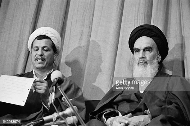 Ayatollah Ruhollah Khomeini with Ali Akbar Hashemi Rafsanjani as the new government is presented after the Iranian Revolution