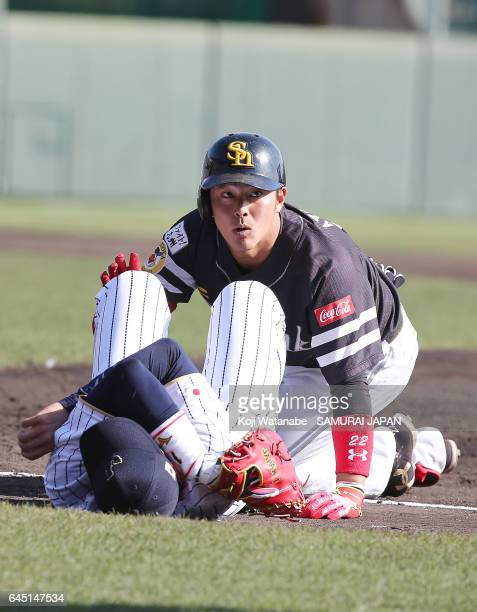 Ayatsugu Yamashita of Fukuoka SoftBank Hawks looks up after crashing with Seiichi Uchikawa of Samurai Japan in the eighth inning during the SAMURAI...