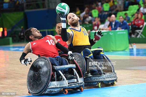 Ayaz Bhuta of Great Britain and Andreas Collin of Sweden compete for the ball in the wheelchair rugby 5th6th classification on day 10 of the Rio 2016...