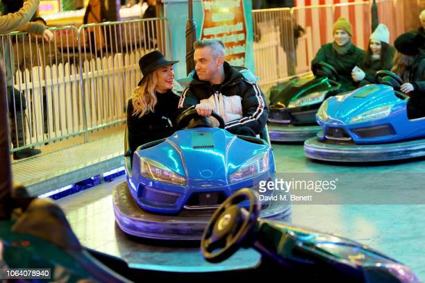 Ayda Field and Robbie Williams attend the VIP preview night for Hyde Park Winter Wonderland on November 21 2018 in London England