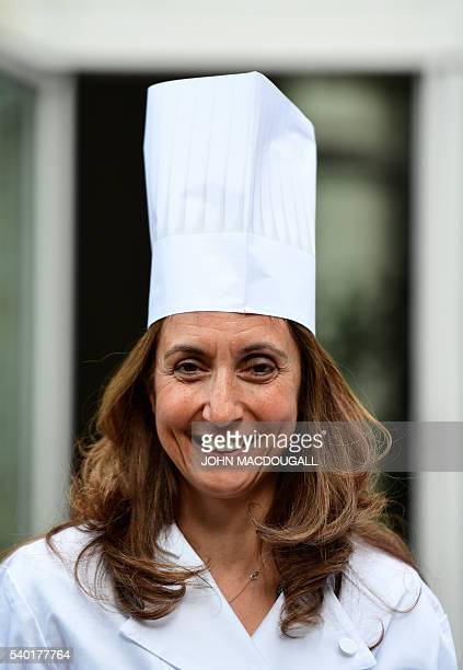 Aydan Ozoguz German Commissioner for Immigration Refugees and Integration poses wearing a chef's toque before helping Syrian refugees cook for an...