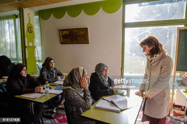 Aydan Ozoguz German Federal Commissioner for Immigration Refugees and Integration meets muslim women from Syria as she visits the Muslim cultural...