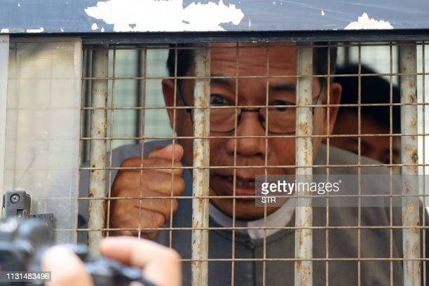 Aye Maung, Ann Township MP and former Arakan National Party leader, speaks to the media as he is escorted out of court after his hearing in Sittwe,...