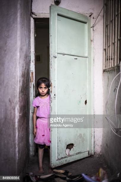 Aye of Syrian Deyh family looks behind of a half way open door in Altindag district of Ankara Turkey on July 26 2017 Deyh family fled the ongoing...