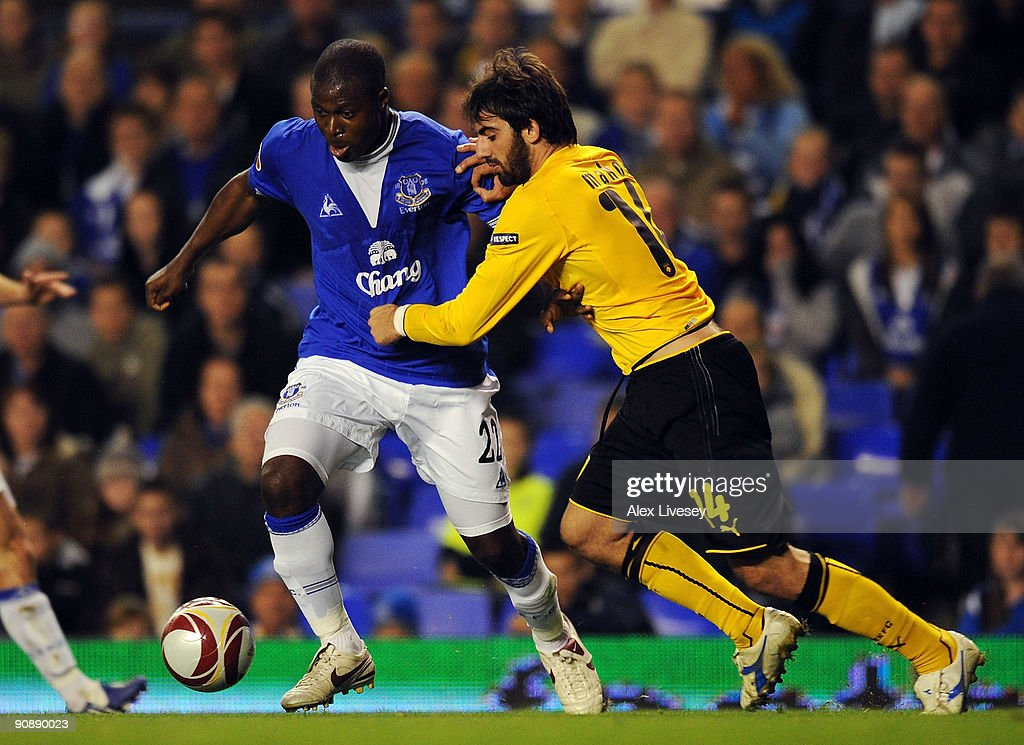 Ayegbeni Yakubu of Everton holds off a challenge from Grigoris Makos of AEK Athens during the UEFA Europa League Group I match between Everton and AEK Athens at Goodison Park on September 17, 2009 in Liverpool, England.