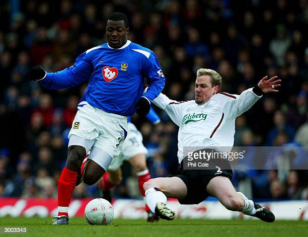 Ayegbeni Yakubu of Portsmouth battles with Stephane Henchoz of Liverpool during the FA Cup Fifth Round Replay match between Portsmouth and Liverpool...