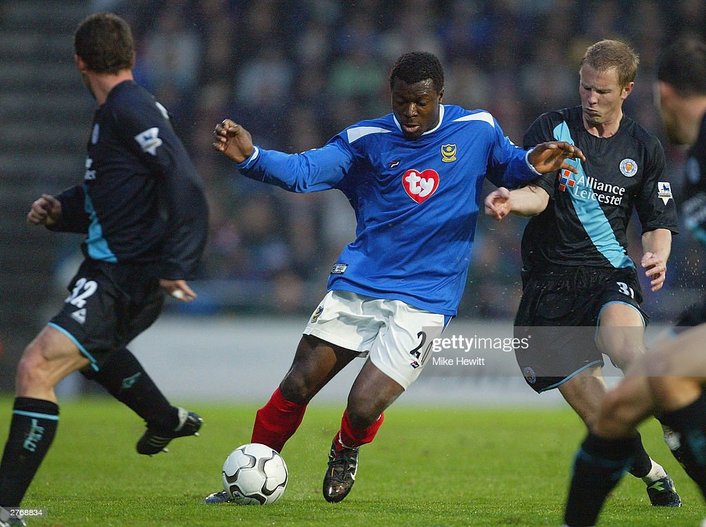 Ayegbeni Yakubu of Portsmouth is challenged by Billy McKinlay and Ben Thatcher of Leicester City during the FA Barclaycard Premiership match between Portsmouth and Leicester City at Fratton Park on November 29, 2003 in Portsmouth, England.