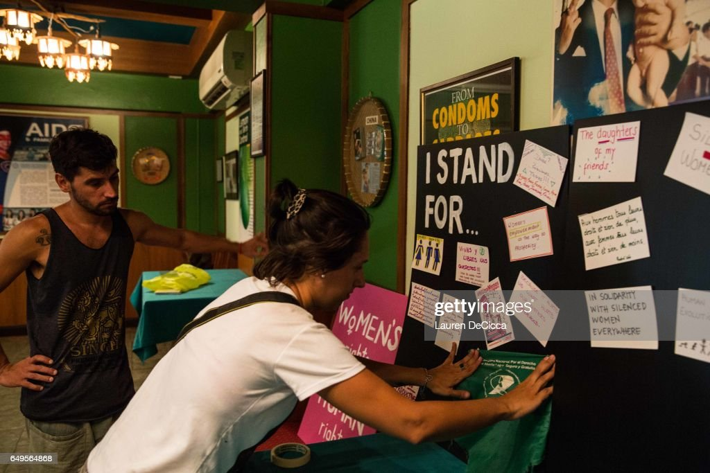 Ayelen Marquez, a tourist from Argentina, posts a banner from a reproductive healthcare campaign onto the 'I stand for' message board at a Women's Day event on March 8, 2017 in Bangkok, Thailand. International Women's Day was first marked in 1911 and celebrated each year on 08 March with thousands of events around the world by women's networks.