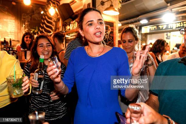 Ayelet Shaked chairwoman of Israel's United Right party toasts with youths while on an election campaign tour at the Mahane Yehuda market in...
