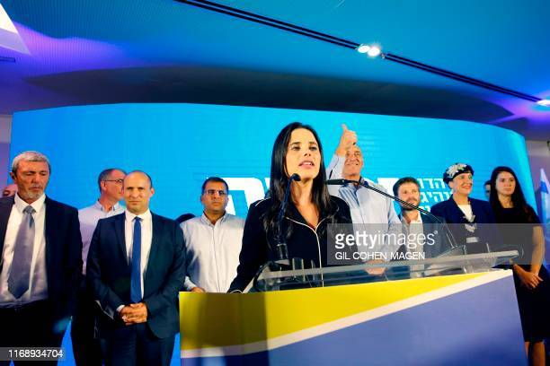 Ayelet Shaked leader and candidate of the New Right party that is part of the Yamina political alliance speaks while flanked by New Right party...