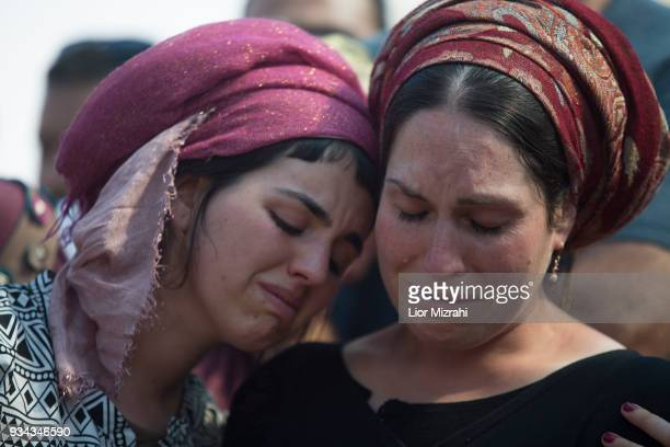 Ayelet wife of Israeli Adiel Coleman mourns over his grave during his funeral on March 19 2018 in Kochav Hashahar settlement West Bank Hundreds...