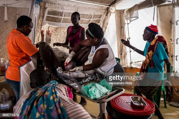 Image contains graphic content Ayen Majok Ariik is delivering her first child at Healtlink clinic She is from a kettle camp and came to the facility...