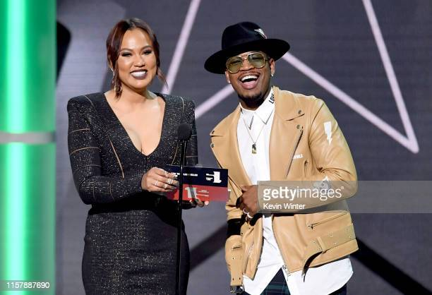 Ayesha Curry and NeYo speak onstage at the 2019 BET Awards on June 23 2019 in Los Angeles California