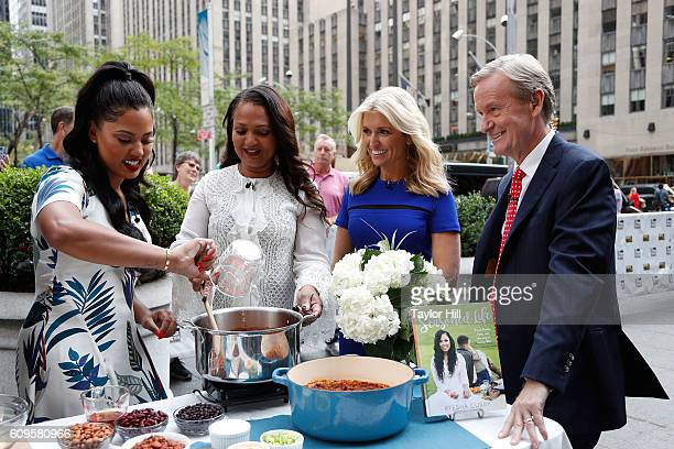 Ayesha Curry Carol Alexander Ainsley Earhardt and Steve Doocy enjoy a chili cooking session on Fox and Friends at FOX Studios on September 21 2016 in...