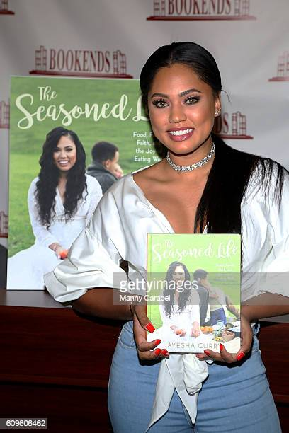 """Ayesha Curry signs copies of her book """"The Seasoned Life"""" at Bookends Bookstore on September 21, 2016 in Ridgewood, New Jersey."""