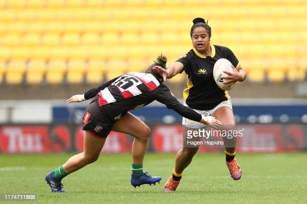 Ayesha Letiliga of Wellington fends Emily Kitson of Counties Manukau during the round 3 Farah Palmer Cup match between Wellington and Counties...