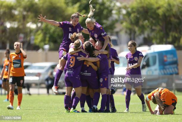 Ayesha Norrie of the Perth Glory is congratulated by team mates after scoring a goal during the round 12 W-League match between Perth Glory and...