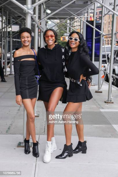Ayesha Sesay is seen wearing a black ASOS top Symone wearing a black Vetenents hoodie a black Marc Jacobs strap and a Louis Vuitton bag Cassidy Bundy...