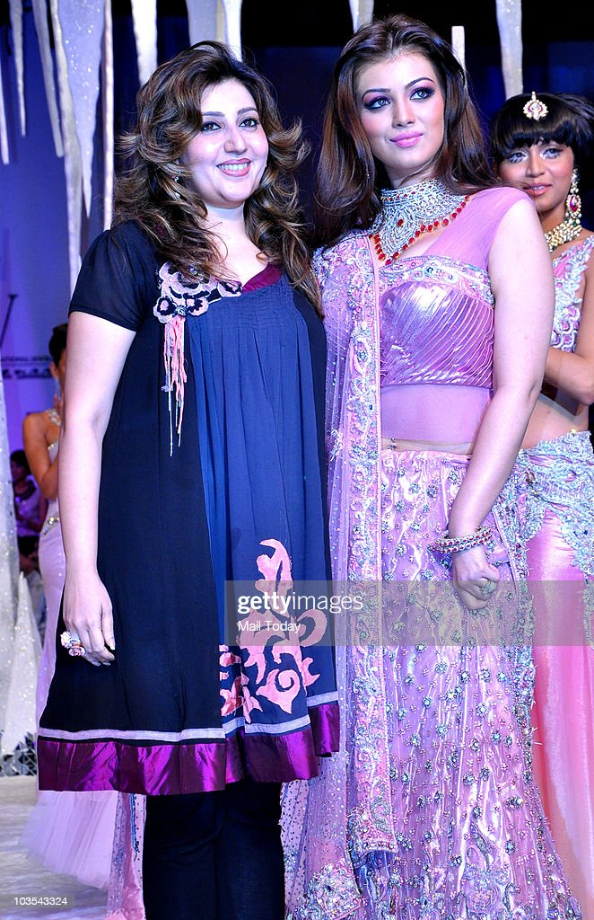 Ayesha Takia walks the ramp with designer Archana Kochchar at the India International Jewellery week in Mumbai on August 19 2010