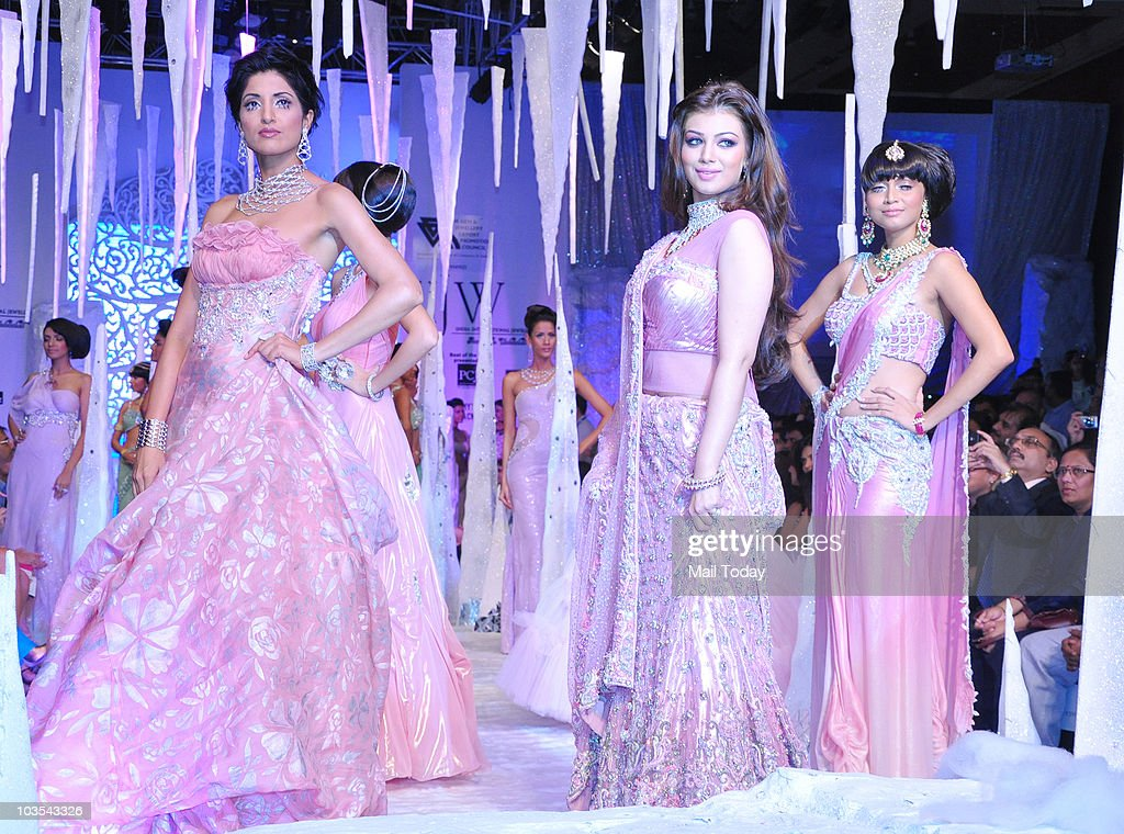Ayesha Takia walks the ramp with other models at the India International Jewellery week in Mumbai on August 19 2010