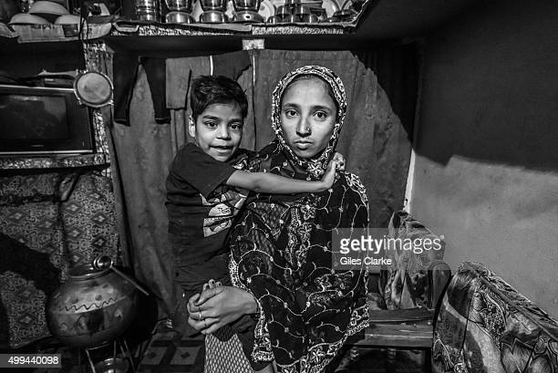 Ayez 8 years old at home woth his mother Shabana in the Tila Jamalpura neighborhood Ayez was born to parents contaminated by a carcinogenic and...
