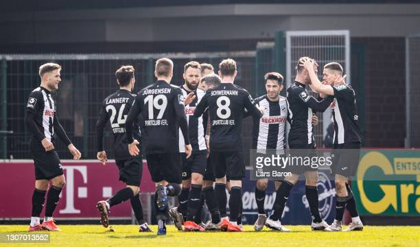 Ayguen Yildirim of Verl celebrates with team mates after scoring his teams second goal during the 3. Liga match between SC Verl and SpVgg...