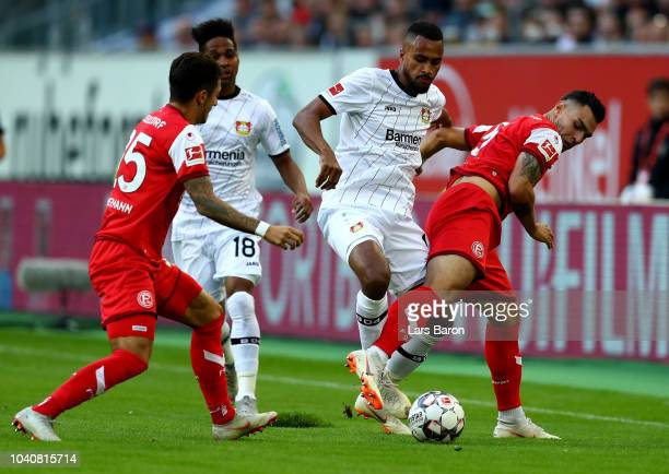 Ayhan Kaan of Duesseldorf and Isaac Kiese Thelin of Leverkusen battle for the ball during the Bundesliga match between Fortuna Duesseldorf and Bayer...