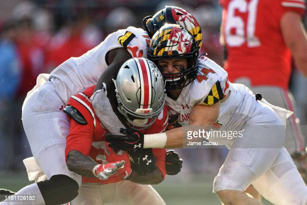 Ayinde Eley and Chance Campbell of the Maryland Terrapins bring down ballcarrier Demario McCall of the Ohio State Buckeyes in the fourth quarter at...